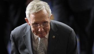 **FILE** Senate Majority Leader Harry Reid of Nev. walks out of the House Chamber on Capitol Hill in Washington on Jan. 4, 2013, following the counting of Electoral College votes. (Associated Press)