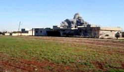 In this image taken from video obtained from the Shaam News Network, which has been authenticated based on its contents and other AP reporting, smoke rises due to heavy shelling in Taftanaz, in the Idlib province of northern Syria on Jan. 10, 2013. (Associated Press/Shaam News Network via AP video)