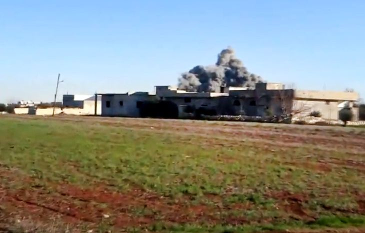 In this image taken from video obtained from the Shaam News Network, which has been authenticated based on its contents and other AP reporting, smoke rises due to heavy shelling in Taftanaz, in the Idlib pr