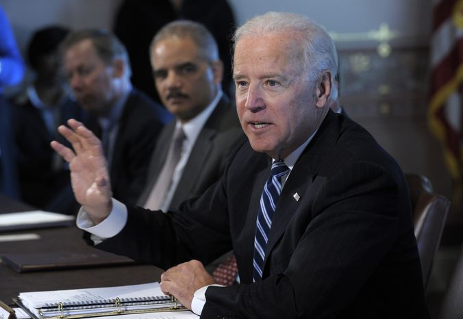 Vice President Joseph R. Biden (right), accompanied by Attorney General Eric H. Holder Jr., speaks during a meeting with sportsmen and sportswomen and wildlife interest groups on Thursday, Jan. 10, 2013, in the Eisenhower Executive Office Building at the White House complex in Washington. Mr. Biden is holding a series of meetings this week as part of the effort to develop policy proposals in response to the Newtown, Conn., school shootings. (AP Photo/Susan Walsh)