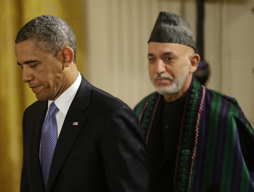 President Obama and Afghan President Hamid Karzai arrive for their joint news conference in the East Room of the White House in Washington on Jan. 11, 2013. (Associated Press)