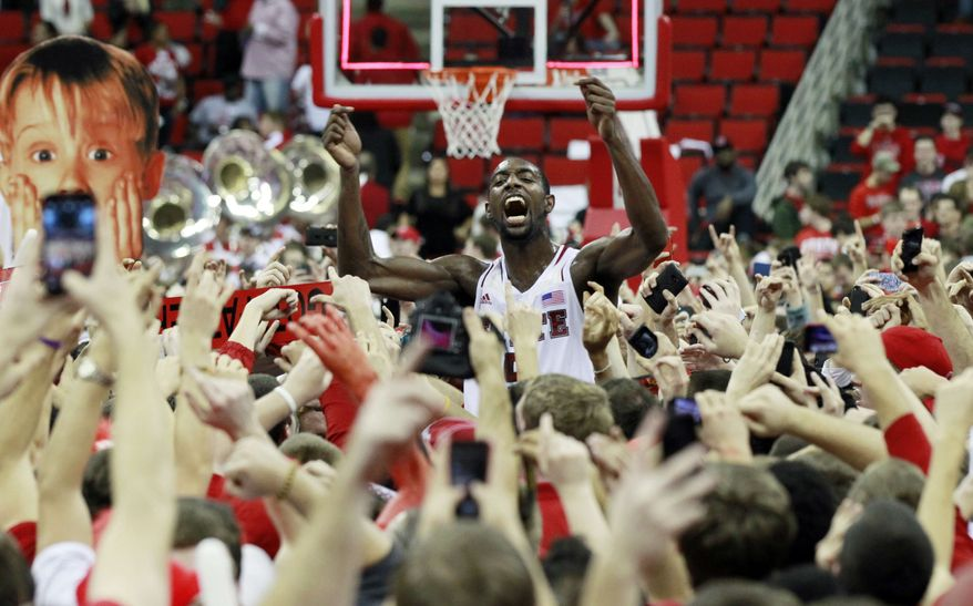 North Carolina State's C.J. Leslie (5) celebrates with the fans after the Wolfpack's 84-76 win over top-ranked Duke in Raleigh, N.C., Saturday, Jan. 12, 2013. (AP Photo/The News & Observer, Ethan Hyman)