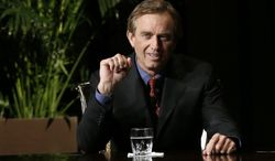 Robert F. Kennedy Jr., left, makes comments during the opening minutes of a interview with journalist Charlie Rose in front of a full audience at the AT&T Performing Arts Center Friday, Jan. 11, 2013, in Dallas, Texas. The Kennedys are in Dallas as a year of observances begins for the 50th anniversary of President John F. Kennedy's assassination. (AP Photo/Tony Gutierrez)