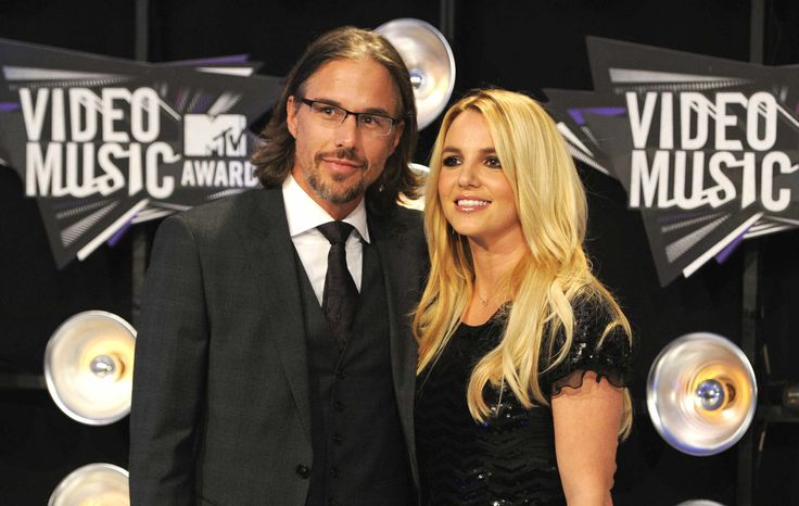 ** FILE ** In this Aug. 28, 2011, file photo, Jason Trawick and Britney Spears arrive at the MTV Video Music Awards in Los Angeles. A judge says Spears' one-time fiance Jason Trawick has resigned as her co-conservator on Friday, Jan. 11, 2013. (AP Photo/Chris Pizzello, file)