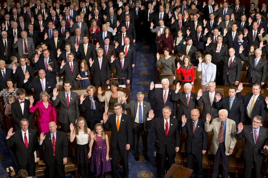 Members of the 113th Congress, many accompanied by family members, take the oath of office in the House of Representatives chamber at the U.S. Capitol in Washington on Thursday, Jan. 3, 2013. (AP Photo/J. Scott Applewhite)