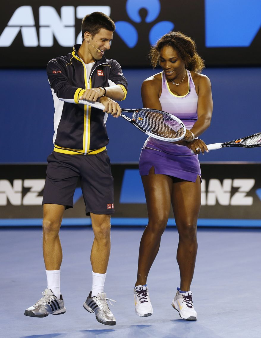 Serbia's Novak Djokovic and Serena Williams of the US perform the gangnam style dance during the Kids Tennis Day at Melbourne Park ahead of the Australian Open tennis championship in Melbourne, Australia, Saturday, Jan. 12, 2013. (AP Photo/Andy Wong)
