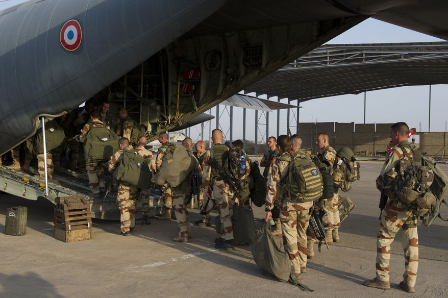 French soldiers of the 21st Marine Infantry Regiment board a plane for Bamako, the Mali capital, at N'Djamena's airport in Chad on Friday, Jan. 11, 2013. The battle to retake Mali's north from the al-Qaeda-linked groups controlling it began in earnest Saturday, after hundreds of French forces deployed to the country and began aerial bombardments to drive back the Islamic extremists from a town seized earlier this week. (AP Photo/ R.Nicolas-Nelson, French Army Communications Audiovisual Office [ECPAD])
