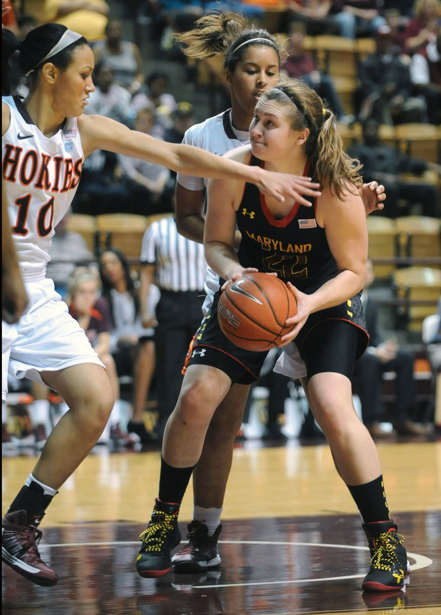 Maryland's Tierney Pfirman (22) looks to shoot as Virginia Tech's Lauren Evans (10) defends during the first half of an NCAA college basketball game Sunday, Jan. 13, 2013 at Cassell Coliseum, in Blacksburg, Va. (AP Photo/Don Petersen)