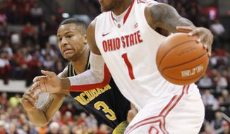 Ohio State's DeShaun Thomas (1) drives as Michigan's Trey Burke (3) tries to keep up during the first half of an NCAA college basketball game Sunday, Jan. 13, 2013 in Columbus, Ohio. Ohio State won 56-53. (AP Photo/Mike Munden)