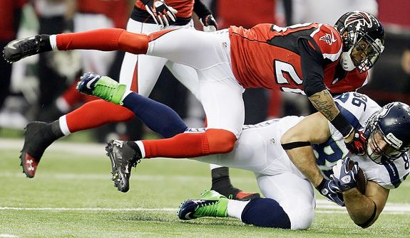 Seattle Seahawks tight end Zach Miller (86) makes the catch against Atlanta Falcons free safety Thomas DeCoud (28) during the first half of an NFC divisional playoff NFL football game Sunday, Jan. 13, 2013, in Atlanta. (AP Photo/David Goldman)