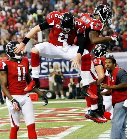 Atlanta Falcons fullback Jason Snelling (44) celebrates his touchdown run with quarterback Matt Ryan (2) during the second half of an NFC divisional playoff NFL football game against the Seattle Seahawks Sunday, Jan. 13, 2013, in Atlanta. (AP Photo/John Bazemore)