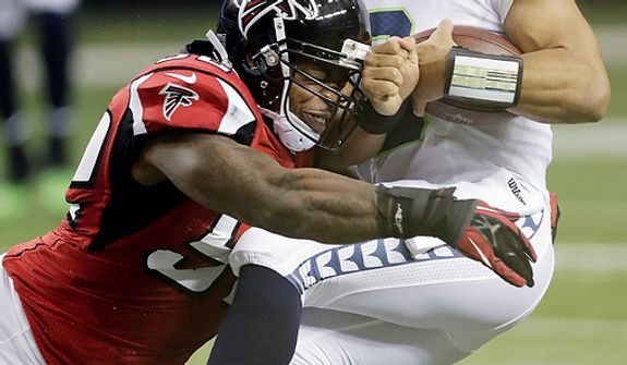 Seattle Seahawks quarterback Russell Wilson (3) is sacked by Atlanta Falcons middle linebacker Akeem Dent (52) during the first half of an NFC divisional playoff NFL football game Sunday, Jan. 13, 2013, in Atlanta. (AP Photo/Dave Martin)