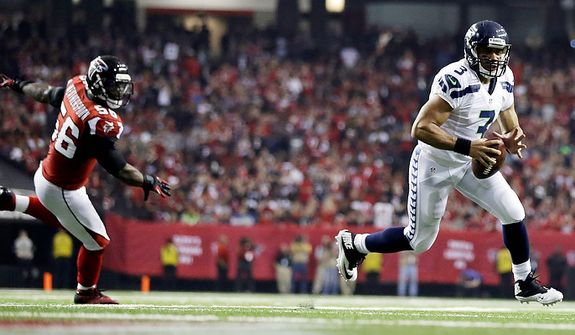 Seattle Seahawks quarterback Russell Wilson (3) runs the ball into the end zone as Atlanta Falcons outside linebacker Sean Weatherspoon (56) looks on during the second half of an NFC divisional playoff NFL football game Sunday, Jan. 13, 2013, in Atlanta. (AP Photo/David Goldman)