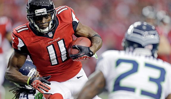 Atlanta Falcons wide receiver Julio Jones (11) works against Seattle Seahawks cornerback Marcus Trufant (23) during the first half of an NFC divisional playoff NFL football game Sunday, Jan. 13, 2013, in Atlanta. (AP Photo/David Goldman)