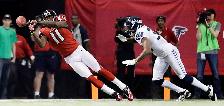 Atlanta Falcons wide receiver Julio Jones (11) works against Seattle Seahawks DeShawn Shead (35) during the second half of an NFC divisional playoff NFL football game Sunday, Jan. 13, 2013, in Atlanta. (AP Photo/David Goldman)