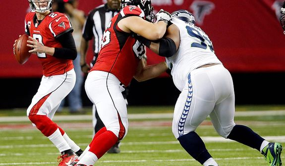 Atlanta Falcons guard Peter Konz (66) blocks Seattle Seahawks defensive tackle Brandon Mebane (92) as quarterback Matt Ryan (2) drops back to pass during the second half of an NFC divisional playoff NFL football game Sunday, Jan. 13, 2013, in Atlanta. (AP Photo/John Bazemore)