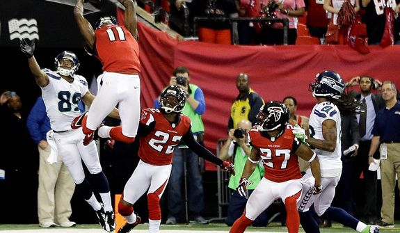 Atlanta Falcons' Julio Jones (11) intercepts a pass on a Seattle Seahawks quarterback Russell Wilson Hail-Mary pass during the second half of an NFC divisional playoff NFL football game Sunday, Jan. 13, 2013, in Atlanta. The Falcons won 30-28. (AP Photo/David Goldman)