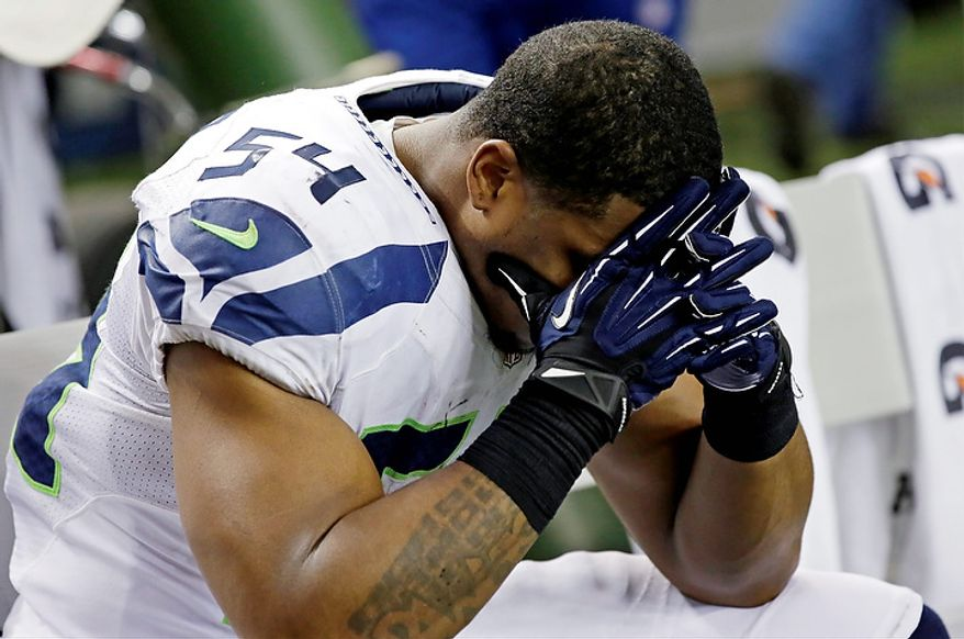 Seattle Seahawks middle linebacker Bobby Wagner (54) sits on the bench during the second half of an NFC divisional playoff NFL football game against the Atlanta Falcons Sunday, Jan. 13, 2013, in Atlanta. The Falcons won 30-28. (AP Photo/Dave Martin)