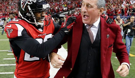 Atlanta Falcons owner Arthur Blank reacts with Atlanta Falcons cornerback Asante Samuel on the sidelines after an NFC divisional playoff NFL football game the Seattle Seahawks Sunday, Jan. 13, 2013, in Atlanta. The Falcons won 30-28. (AP Photo/John Bazemore)