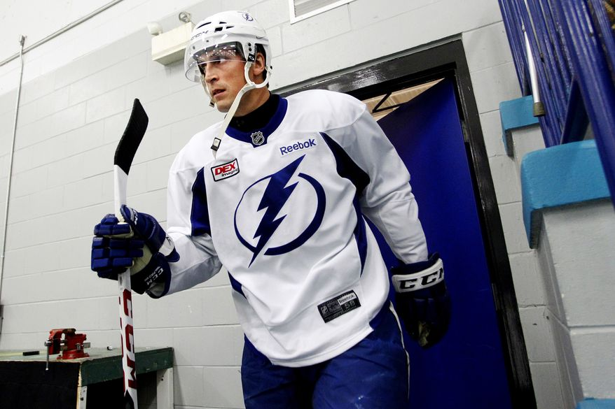 Tampa Bay Lightning captain Vincent Lecavalier takes the ice for the team's first hockey practice since the end of the NHL labor lockout, Monday, Jan. 7, 2013, in Tampa, Fla. (AP Photo/The Tampa Bay Times, Dirk Shadd)