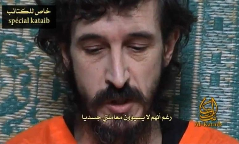 ** FILE ** In this undated file image from a video posted on Islamic militant websites, a man identified as French security agent Denis Allex pleads for his release from the Somali militant group al-Shabaab who have been holding him for nearly a year. (AP Photo, File)