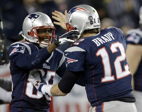 New England Patriots quarterback Tom Brady, right, congratulates teammate Brandon Lloyd after Loyd's five-yard touchdown pass from Brady during the second half of an AFC divisional playoff NFL football game against the Houston Texans in Foxborough, Mass., Sunday, Jan. 13, 2013. (AP Phot