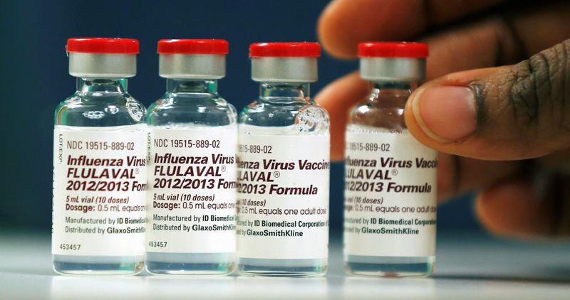 Vials of flu vaccine are displayed at the Whittier Street Health Center in Boston, Mass., Wednesday, Jan. 9, 2013. Boston declared a public health emergency Wednesday as the