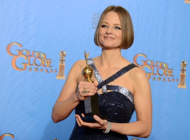 Actress-director Jodie Foster poses with the Cecil B. DeMille Award for outstanding contributions to the entertainment field backstage at the 70th annual Golden Globe Awards at the Beverly Hilton Hotel on Sunday, Jan. 13, 2013, in Beverly Hills, Calif. ( Jordan Strauss/Invision/AP)