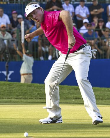 Russell Henley celebrates as he sinks a birdie putt on the 18th green, winning the Sony Open golf tournament, Sunday, Jan. 13, 2013, in Honolulu. Henley defeated Tim Clark by three strokes. (AP Photo/Marco Garcia)