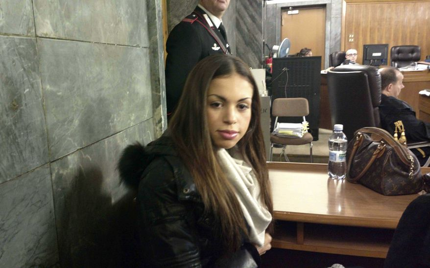 Karima el-Mahroug, the Moroccan woman at the center of ex-Italian Premier Silvio Berlusconi's sex-for-hire trial, sits in a courtroom in Milan on Monday, Jan. 14, 2013. (AP Photo/Luca Bruno)