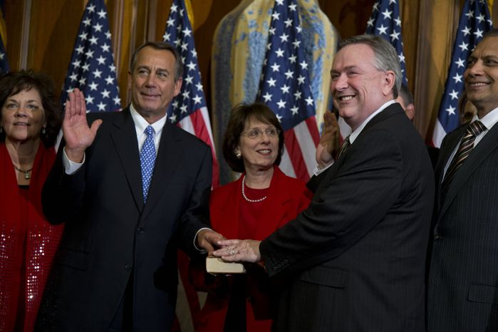 **FILE** Rep. Steve Stockman (second from right), Texas Republican, participates in a mock swearing-in ceremony with Speaker of the House Rep. John Boehner, Ohio Republican, for the 113th Congress in Washington on Jan. 3, 2013. (Associated Press)