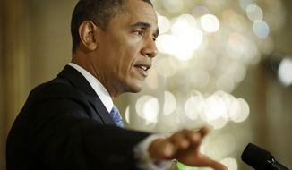 President Obama gestures as he answers questions from members of the media during a news conference in the East Room of the White House in Washington on Monday, Jan. 14, 2013. (AP Photo/Pablo Martinez Monsivais)