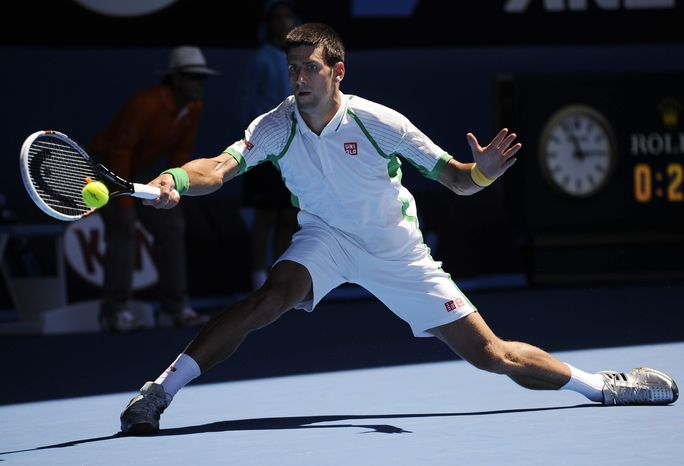 Serbia's Novak Djokovic hits a forehand return to France's Paul-Henri Mathieu during their first round match at the Australian Open tennis championship in Melbourne, Australia, Monday, Jan. 14, 2013. (AP Photo/Andrew Brownbill)
