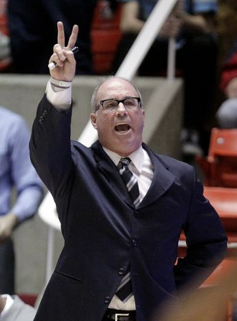 Southern California head coach Kevin O'Neill calls a play in the first half during an NCAA basketball game against Utah on Saturday, Jan. 12, 2013, in Salt Lake City. (AP Photo/Rick Bowmer)