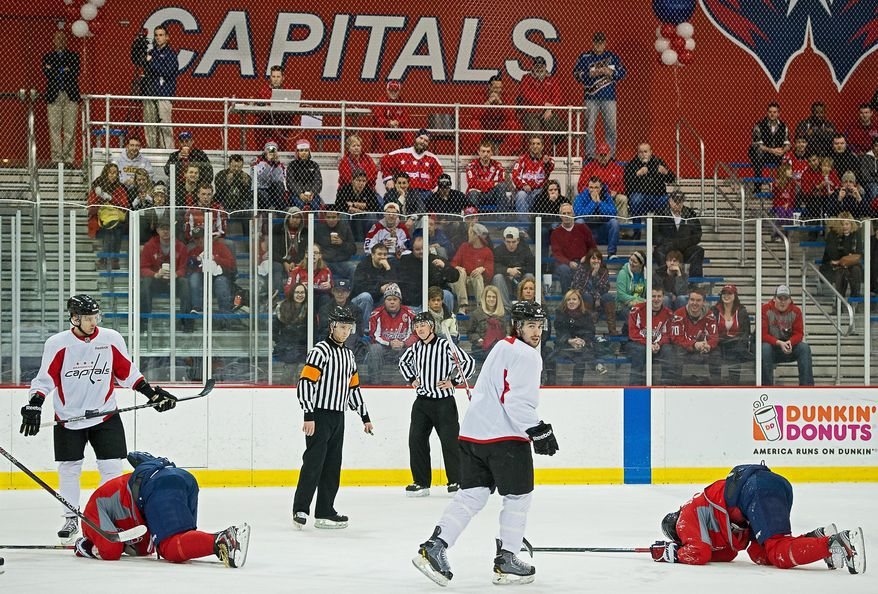 Washington's Alex Ovechkin (left) and Marcus Johansson (right) escaped serious injury Tuesday after they collided during a scrimmage at Kettler Capitals Iceplex. Ovechkin, who is getting a chance to play right wing for the first time, said unfamiliarity with his new position contributed to the collision. (Andrew Harnik/The Washington Times)