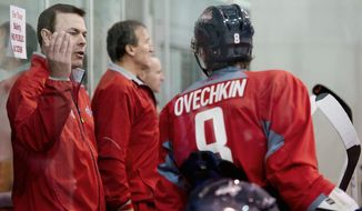 Capitals coach Adam Oates (left) talks with left wing Alex Ovechkin on Tuesday during a scrimmage against the Reading Royals at Kettler Capitals Iceplex. (Andrew Harnik/The Washington Times)