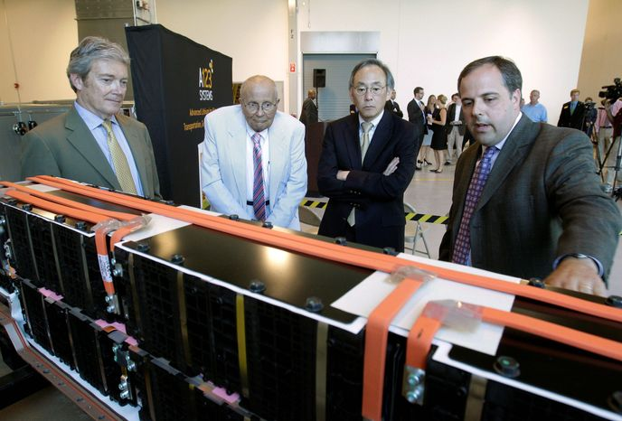 Jason Forcier (right), vice president and general manager of A123 Systems Inc., shows off a lithium-ion battery at a plant in Romulus, Mich., in 2011 to (from left) A123 President and CEO David Vieau, Rep. John D. Dingell, Michigan Democrat, and Energy Secretary Steven Chu. Now in bankruptcy, the pending sale of A123 to a China-based company has vendors and stockholders trying to recoup some of they money they have lost. (Associated Press)