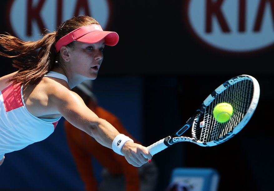 Poland's Agnieszka Radwanska stretches for a return to Romania's Irina-Camelia Begu during their second-round match at the Australian Open tennis championship in Melbourne, Australia, on Wednesday, Jan. 16, 2013. (AP Photo/Greg Baker)