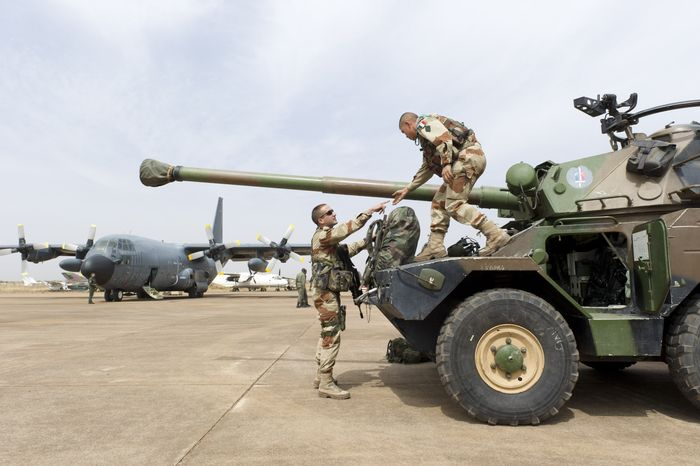 """Legionnaires of France's 1st Foreign Cavalry Regiment, based in Orange, France, deploy at the airport in Bamako, Mali. An official at France's Defense Ministry says the country will """"gradually deploy"""" a total of 2,500 troops to Mali, and the French president says the military operation will last until security has been restored and African forces are ready to take charge. (AP Photo/Arnaud Roine, French Army Communications Audiovisual Office [ECPAD])"""
