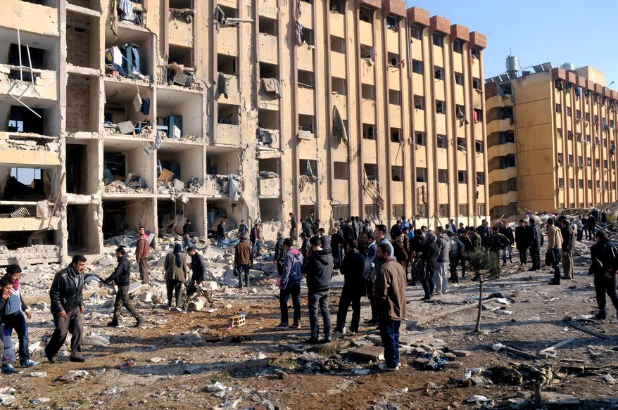 Syrians gather at the site of an explosion at Aleppo University in Aleppo, Syria, on Tuesday, Jan. 15, 2013. Two blasts struck the main university in the city, the country's largest and its commercial capital, causing more than 50 casualties, state media said. There were conflicting reports as to what caused the blasts at the university, which was in session. (AP Photo/SANA)