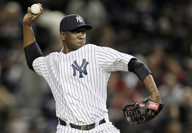 ** FILE ** In this Oct. 13, 2012, file photo, New York Yankees' pitcher Rafael Soriano throws in the tenth inning of Game 1 of baseball's American League championship series against the Detroit Tigers in New York. A person familiar with the negotiations says Soriano and the Washington Nationals are working to finalize a $28 million, two-year contract. The person spoke to The Associated Press on Tuesday, Jan. 15, 2013, on condition of anonymity beca