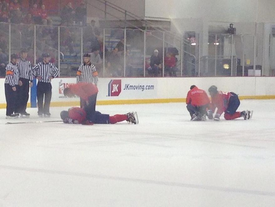 Alex Ovechkin (left) and Marcus Johansson collided during the Capitals' training camp scrimmage Tuesday. (Stephen Whyno / The Washington Times)