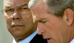 Secretary of State Colin Powell looks April 4, 2002, on as President Bush makes a statement in the Rose Garden of the White House. (Associated Press) **FILE**