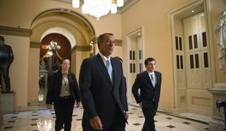 House Speaker John A, Boehner, Ohio Republican, walks to the House chamber on Capitol Hill in Washington on Jan. 15, 2013, as lawmakers debate the details of an emergency spending package to assist victims of Superstorm Sandy that devastated parts of the Northeast coast in October. (Associated Press)