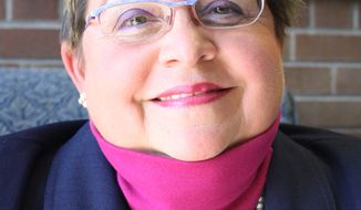 This 2011 photo shows Maria Waltherr-Willard, 61, who taught Spanish and French at Mariemont High School in Cincinnati from 1976 until 2009, when she was transferred to the district's middle school. Waltherr-Willard is suing the school district where she used to work, accusing its administrators of discriminating against her because of a rare phobia she says she has: a fear of young children. (Associated Press/Community Press, Heidi Fallon)