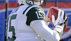 ** FILE **  In a Sunday, Dec. 30, 2012, file photo, New York Jets quarterback Tim Tebow (15) warms up before of an NFL football game against the Buffalo Bills, in Orchard Park, N.Y. (AP Photo/Gary Wiepert)
