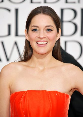 Oscar-winning French actress Marion Cotillard attends the 70th annual Golden Globe Awards in Beverly Hills, Calif., on Sunday, Jan. 13, 2013. (John Shearer/Invision/AP)