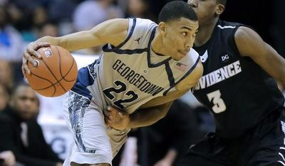 Georgetown forward Otto Porter Jr. (22) drives against Providence guard Kris Dunn (3) during the first half of an NCAA college basketball game, Wednesday, Jan. 16, 2013, in Washington. (AP Photo/Alex Brandon)
