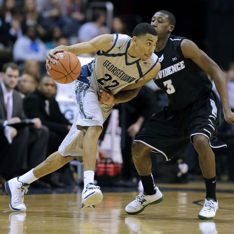 Georgetown forward Otto Porter Jr. (22) drives against Providence guard Kris Dunn (3) during the first half of an NCAA college basketball game, Wednesday, Jan. 16, 2013, in Washingto