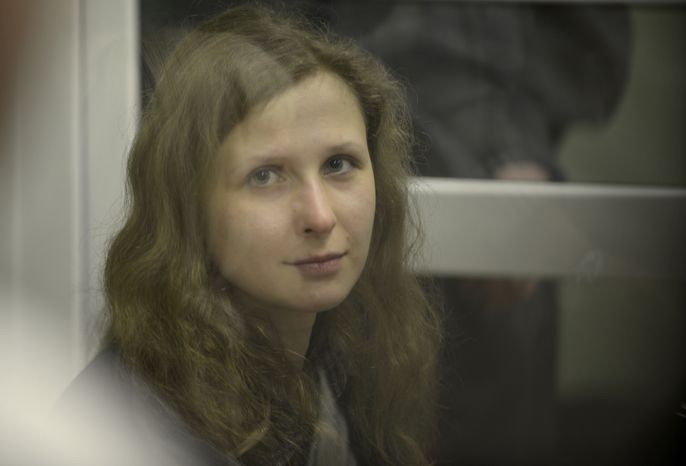 Jailed feminist punk band Pussy Riot member Maria Alekhina is seen in a cell at a courtroom in Berezniki, about 1,500 km (940 miles) northeast of Moscow on Jan. 16, 2013. A Russian court on Wednesday turned down her attempt to defer serving her sentence until her preschool son becomes a teenager. Alekhina was convicted last year along with two other band members of hooliganism motivated by religious hatred for an anti-President Vladimir Putin stunt in Russia's main cathedral. (Associated Press)